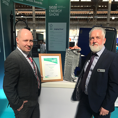 Darren Yourell (left) and Karl Carrick with the SEAI Energy Awards 'Commended' certificate and a section of Upton's innovative heat exchanger.