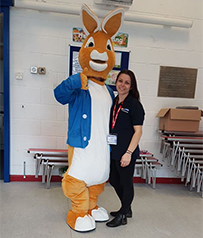 Peter Rabbit and Kelly, trustee of the charity and Hamworthy service team member.