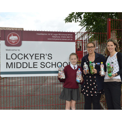 Isabelle Hitchens, her mother Gemma Hitchens (Hamworthy's finance manager) and Sam Boshier (marketing manager) delivered the Ecobricks to the school.