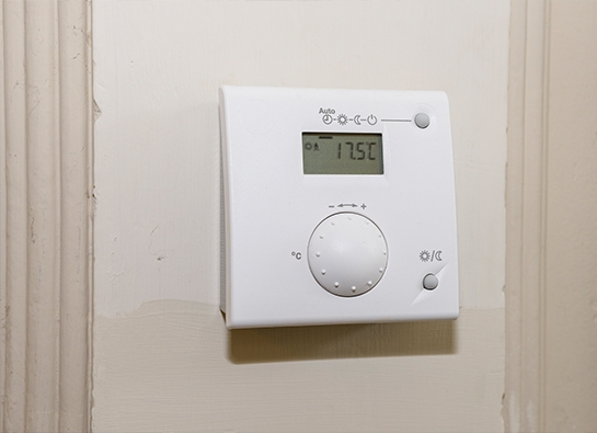 Control thermostat to control a heating zone.